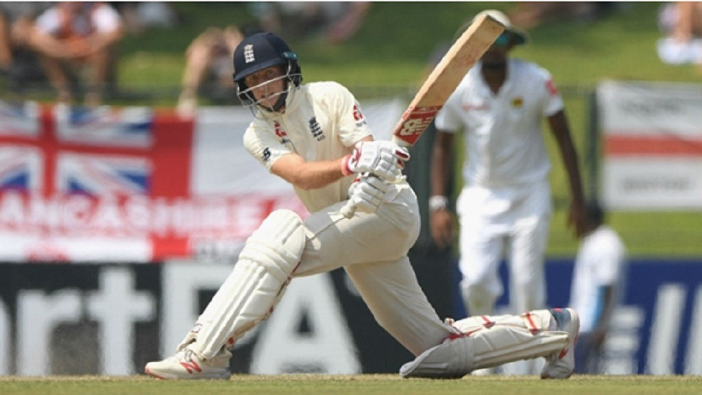England captain Joe Root sweeps during his century in Pallekele.