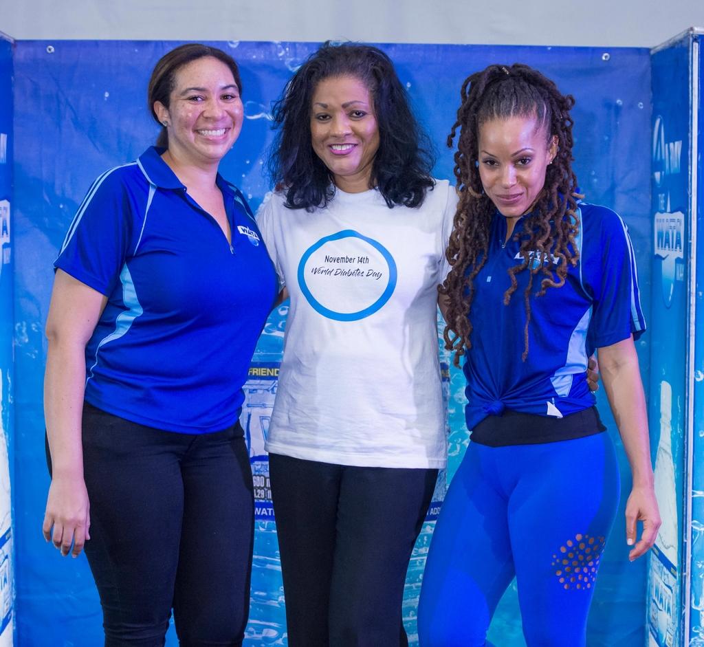 (L-R) Chrys-Ann Crawford, Brand and Trade Marketing Coordinator, Wisynco Group Ltd, Lurline Less, Chairman, Diabetes Association of Jamaica and Kamila McDonald, WATA Brand Ambassador at the WATA Wellness Workout at Emancipation Park on World Diabetes Day.