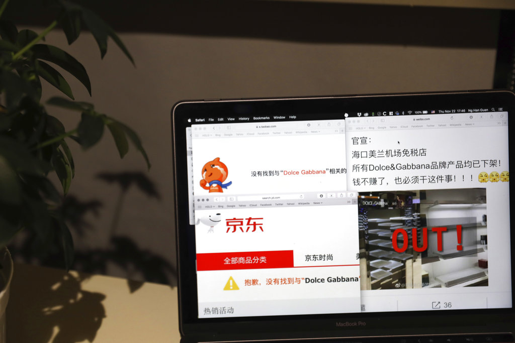 A computer screen shows the online impact on Dolce & Gabbana products displayed in Beijing, China, Thursday, Nov. 22, 2018. Dolce & Gabbana goods have disappeared from Chinese e-commerce sites after insulting remarks about China it allegedly made in exchanges on Instagram sparked outrage. (AP Photo/Ng Han Guan)