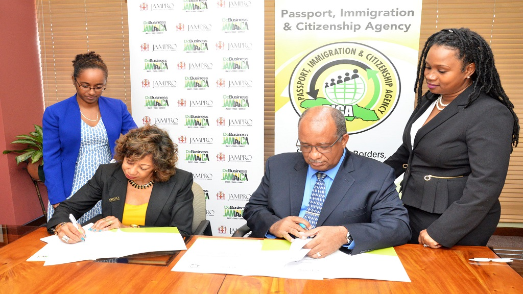 Diane Edwards, President of JAMPRO (seated left) and Andrew Wynter, Chief Executive Officer (CEO) of PICA (seated 