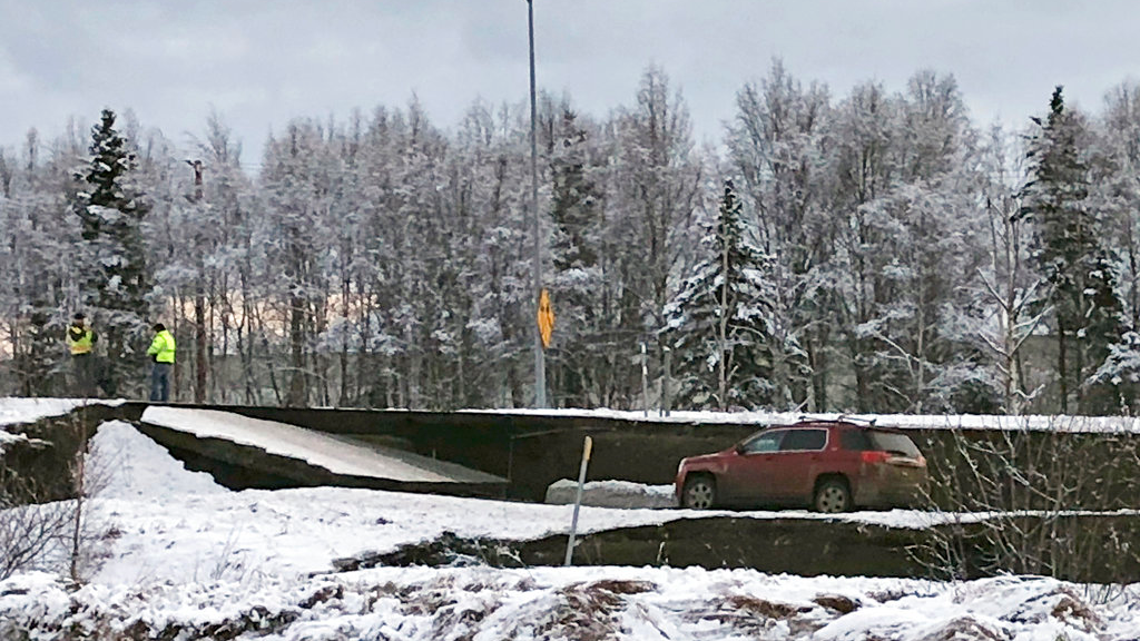A car is trapped on a collapsed section of the offramp off of Minnesota Drive in Anchorage, Friday, Nov. 30, 2018. (AP Photo/Dan Joling)