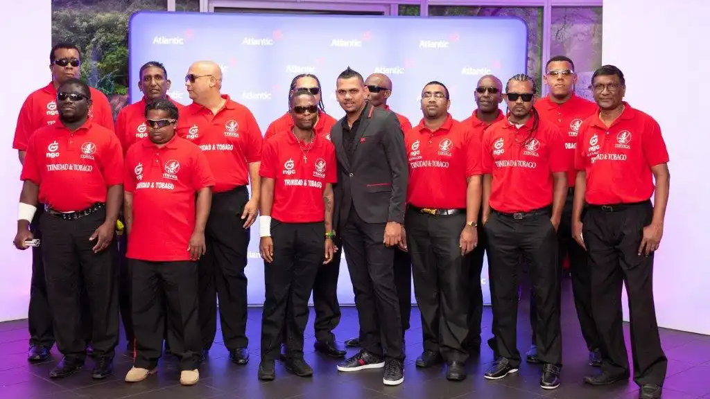 West Indies cricketer and Atlantic Sports Ambassador Sunil Narine with members of the Trinidad and Tobago Blind & Visually Impaired Cricket Association