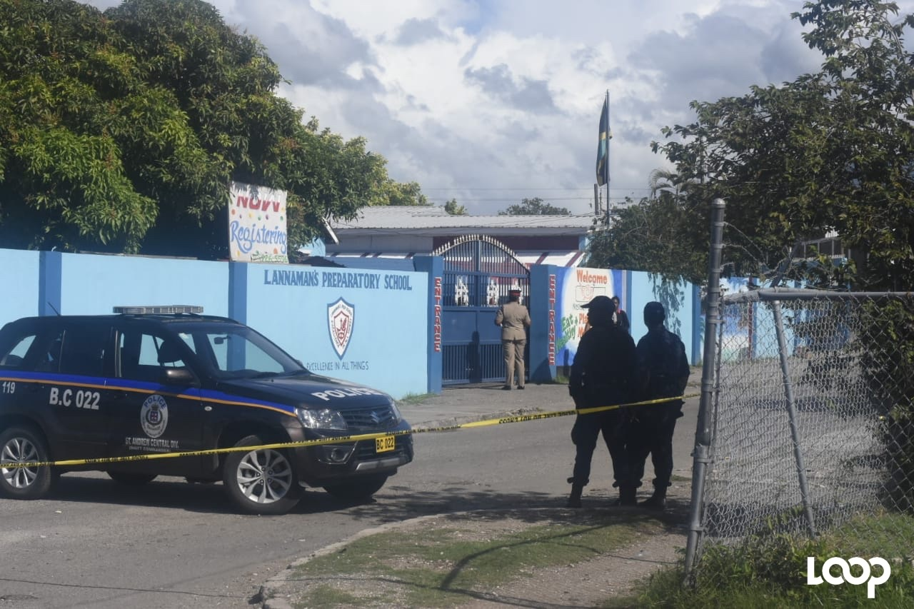 Police officers gather outside Lannaman's Prep, where a male parent was shot dead after dropping off his child at the school on Monday morning. (PHOTOS: Marlon Reid)