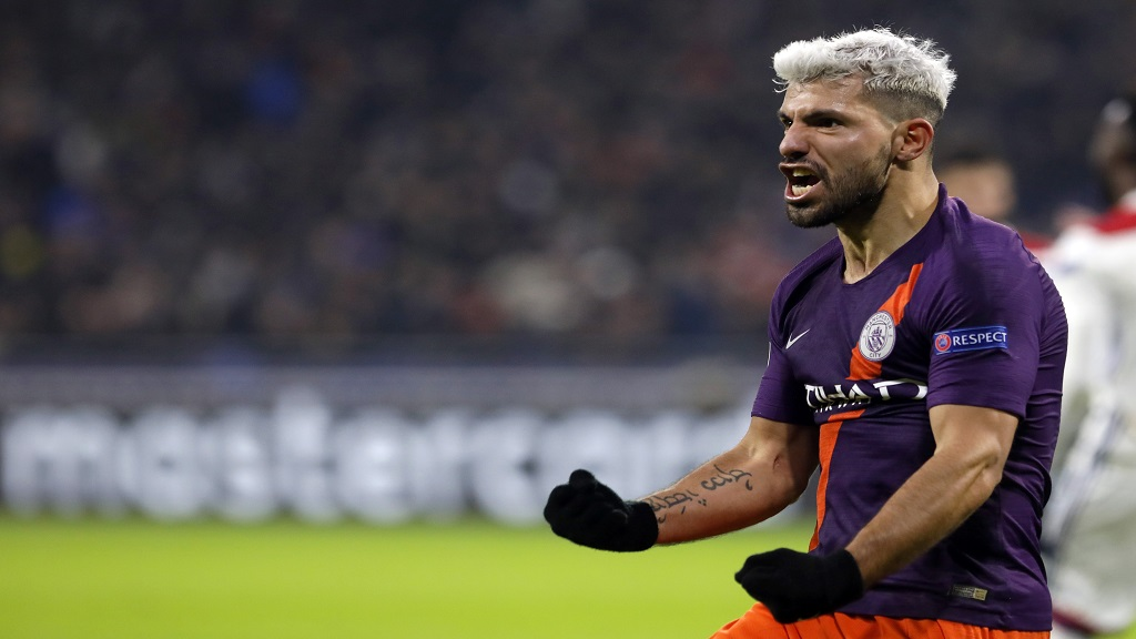 Manchester City forward Sergio Aguero celebrates after scoring his side's second goal during the Champions League Group F second leg football match against Manchester City in Decines, near Lyon, central France, Tuesday, Nov. 27, 2018.