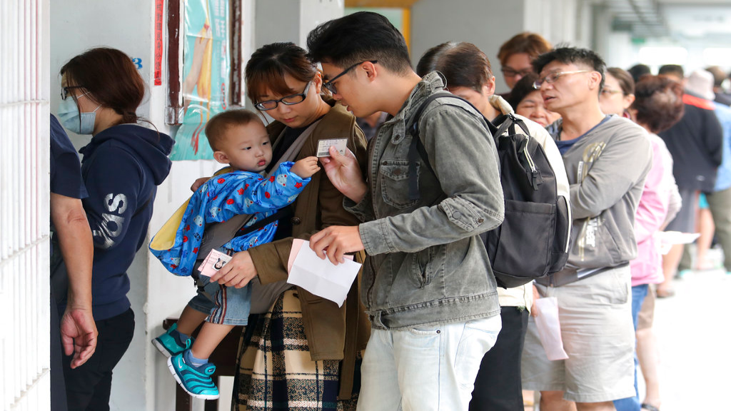 Voters line up at a ballot station to vote for the city mayor in Kaohsiung, Taiwan, Saturday, Nov. 24, 2018. Taiwanese began voting in midterm local elections Saturday seen as a referendum on the independence-leaning administration of President Tsai Ing-wen, amid growing pressure from the island's powerful rival China. (AP Photo)