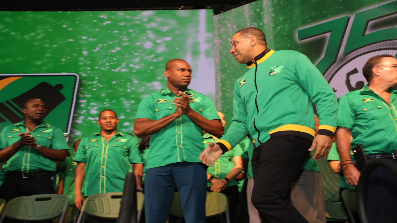A confident-looking Andrew Holness, leader of the Jamaica Labour Party, walks towards the podium on Sunday at the party's Annual Conference. (PHOTO: Llewellyn Wynter)