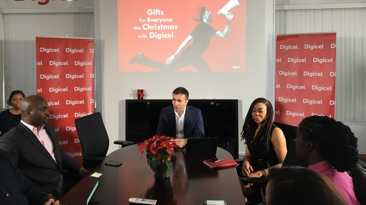 Digicel T&T CEO, Jabbor Kayumov (centre) and Digicel Foundation CEO Penny Gomez (right) engage members of the media at a press conference at Digicel Headquarters on Monday 19 November.