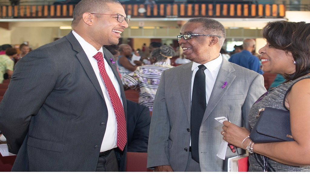 Mikhail Phillips (left) Opposition Spokesperson on Transport and Works makes a point to Dr. Lucien Jones, Vice-Chairman/Convenor of the National Road Safety Council (NRSC) and Paula Fletcher, Executive Director, NRSC at the church service in commemoration of World Day of Remembrance for Road Traffic Victims (WDR) which was held at Boulevard Baptist Church.
