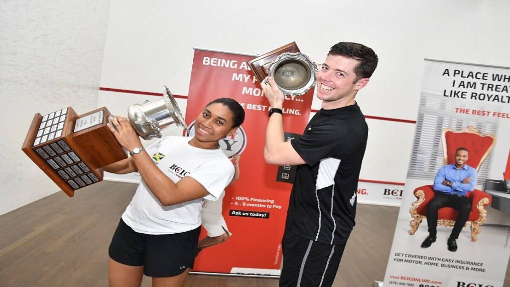 Jamaican and Caribbean number one, Chris Binnie, (right) and  Akelia Wiltshire pose with their trophies after winning the main titles at the BCIC All Jamaica Senior Squash Championships at the Liguanea Club in Kingston.