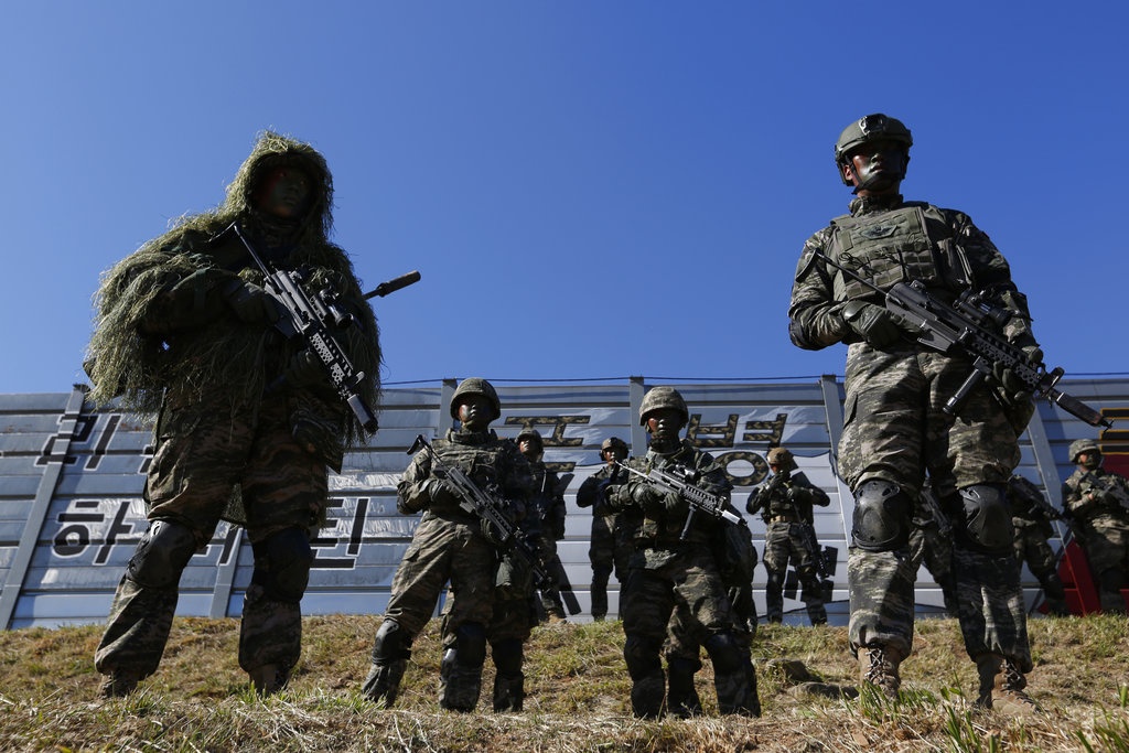 South Korean marines stand in attention during their regular drill on Yeonpyeong Island, South Korea. (Jeon Heon-kyun/Pool Photo via AP)