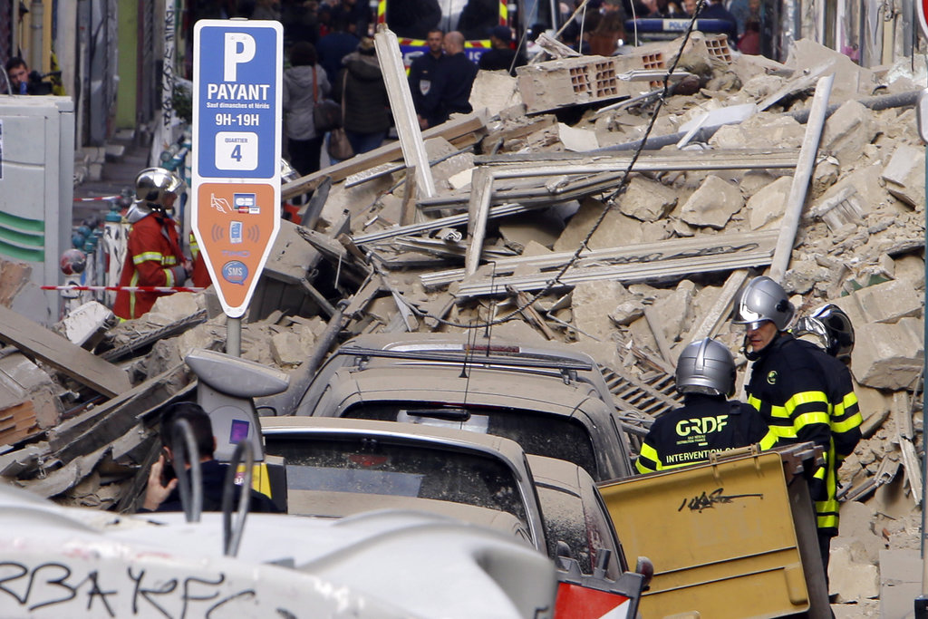 Firefighters work at the scene where a building collapsed In Marseille, southern France. (AP Photo/Claude Paris)