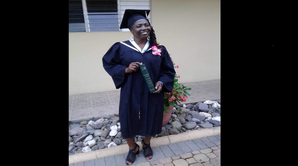 Yasmin Gordon poses with her degree after graduating from the Catholic College of Mandeville.
