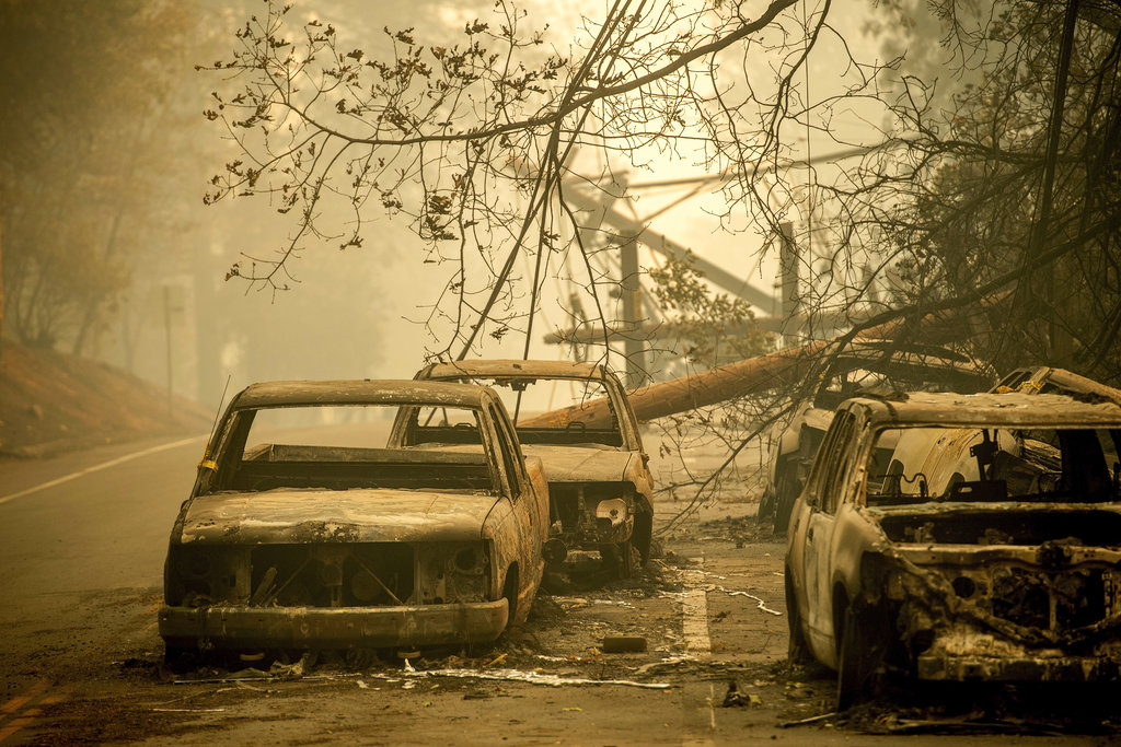 Abandoned cars, scorched by the wildfire, line Pearson Rd. in Paradise, Calif., on Saturday, Nov. 10, 2018. Not much is left in Paradise after a ferocious wildfire roared through the Northern California town as residents fled and entire neighborhoods are leveled. (AP Photo/Noah Berger)