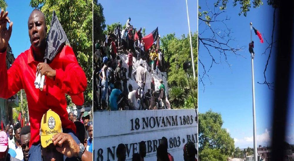 Photo : Le leader de Pitit Dessalines et ses sympathisants hissent le drapeau noir et rouge à Vertières Crédit Photo–  News Anmwe