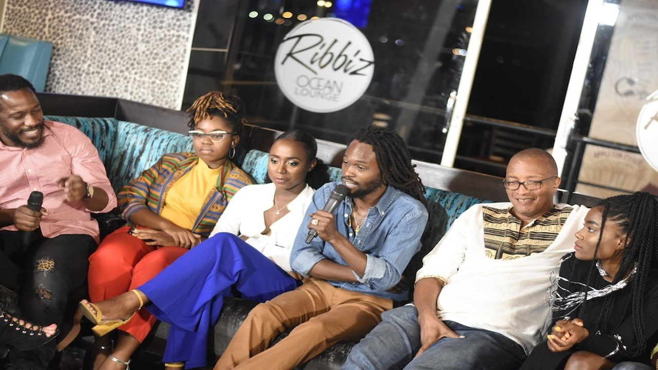 Reggae singer Jesse Royal (third right) talks about his contribution to Appleton's Heart of Jamaica album at the launch event last Wednesday at Ribbiz Ocean Lounge in downtown Kingston. Seated beside him are producer Mikey Bennett (second right) and other recording artistes. (PHOTOS: Marlon Reid)