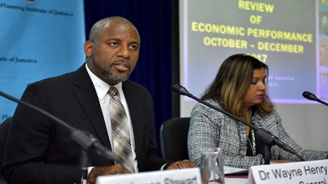 File photo of Dr Wayne Henry, Director General of the Planning Institute of Jamaica, addressing journalists at a PIOJ quarterly press briefing.