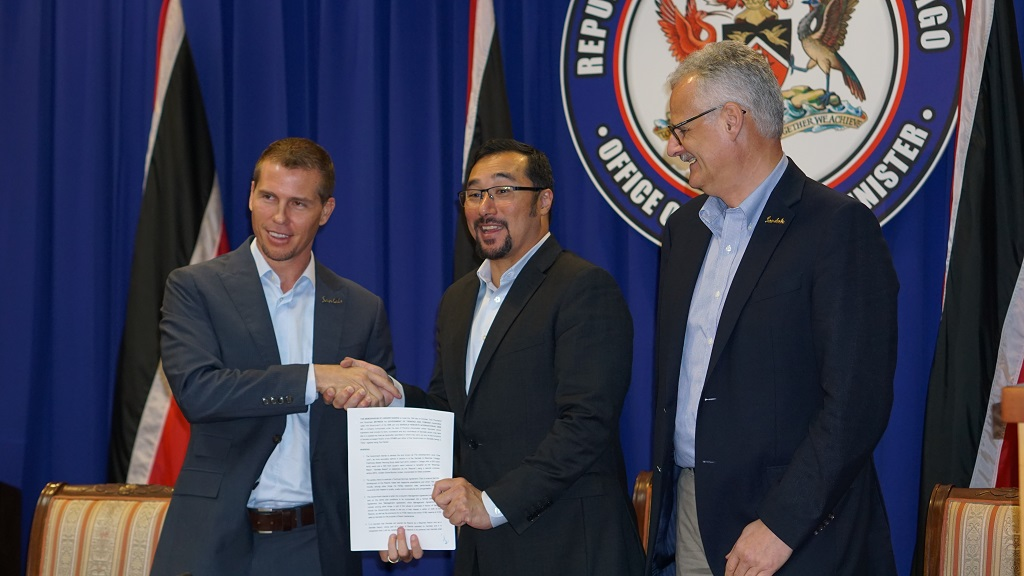 Photo (L-R): Adam Stewart, Sandals Resorts Group Deputy Chairman, Minister of Communications and National Security, Stuart Young, and Sandals Chief Executive Officer, Gebhard F. Rainer show  a Memorandum of Understanding for Sandals Tobago, which was released to the public on November 28, 2018.