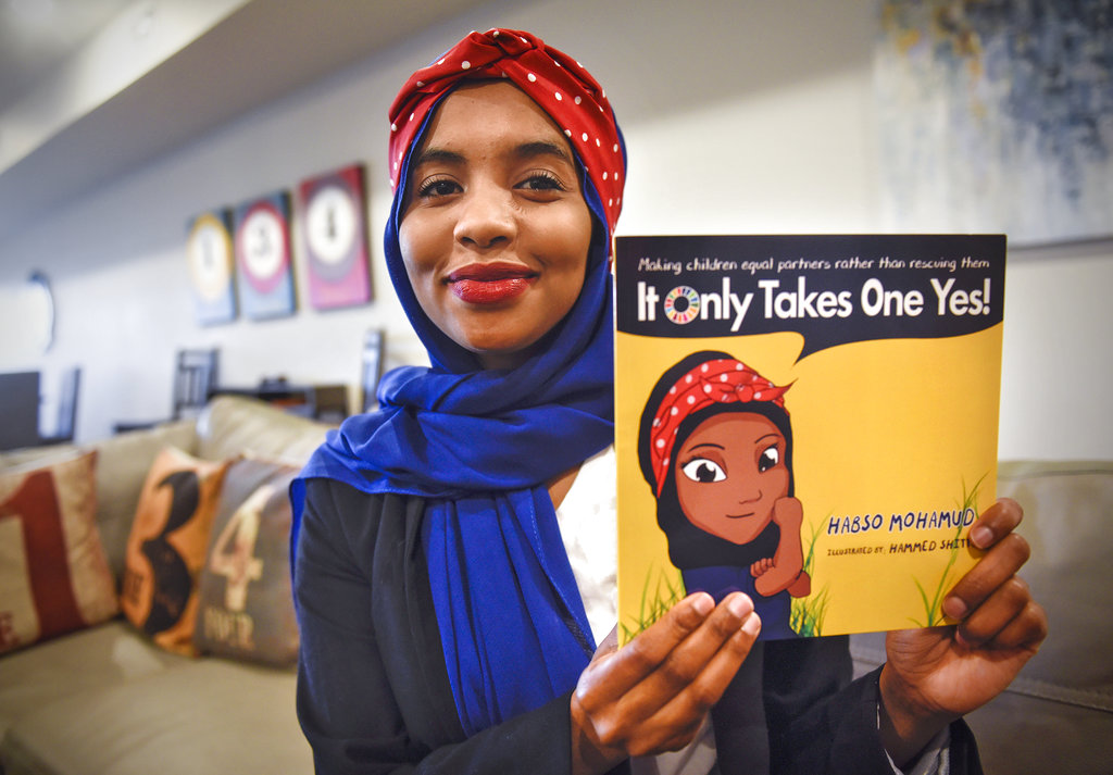 In this Friday, Nov. 2, 2018, photo, Habso Mohamud holds a copy of her book during an interview in St. Cloud, Minn. (Dave Schwarz/St. Cloud Times via AP)