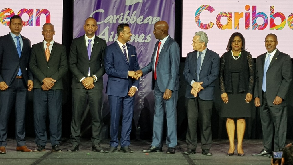 Prime Minister Dr Keith Rowley congratulates CAL Chairman S Ronnie Mohammed at the airline's Customer Appreciation ceremony in T&T.