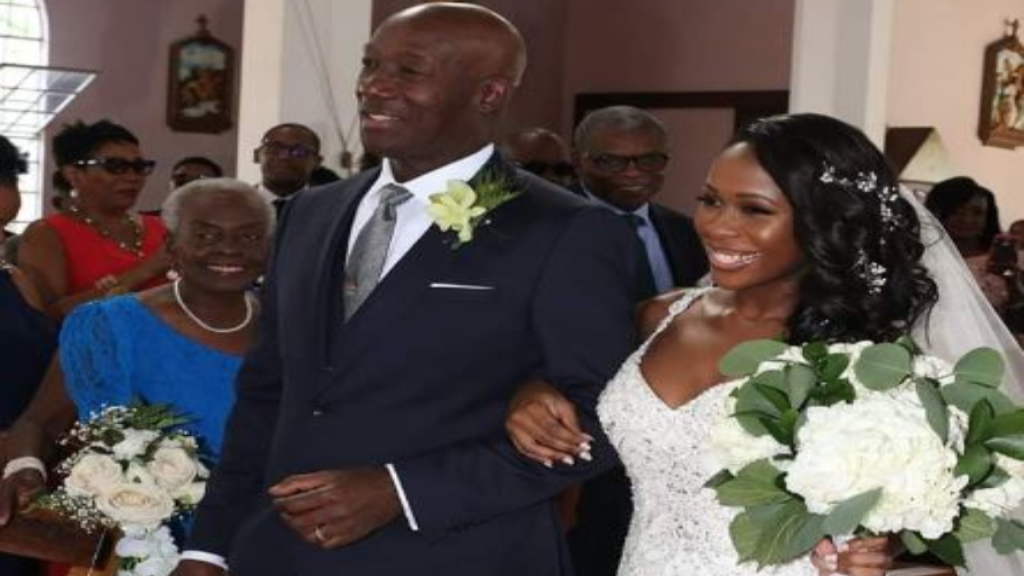 Proud Papa: Prime Minister Dr Keith Rowley walks his daughter, Dr Sonel Rowley, up the aisle. She married Stephan Stewart at the St. Theresa's RC Church on Saturday. Image via Facebook, Dr Keith Rowley.