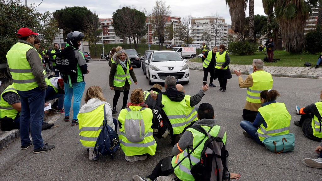 Demonstrators block a crossroads to protest fuel taxes in Marseille, southern France, Tuesday, Nov. 17, 2018. France is bracing for a nationwide traffic mess as drivers plan to block roads to protest rising fuel taxes, in a new challenge to embattled President Emmanuel Macron. (AP Photo/Claude Paris)