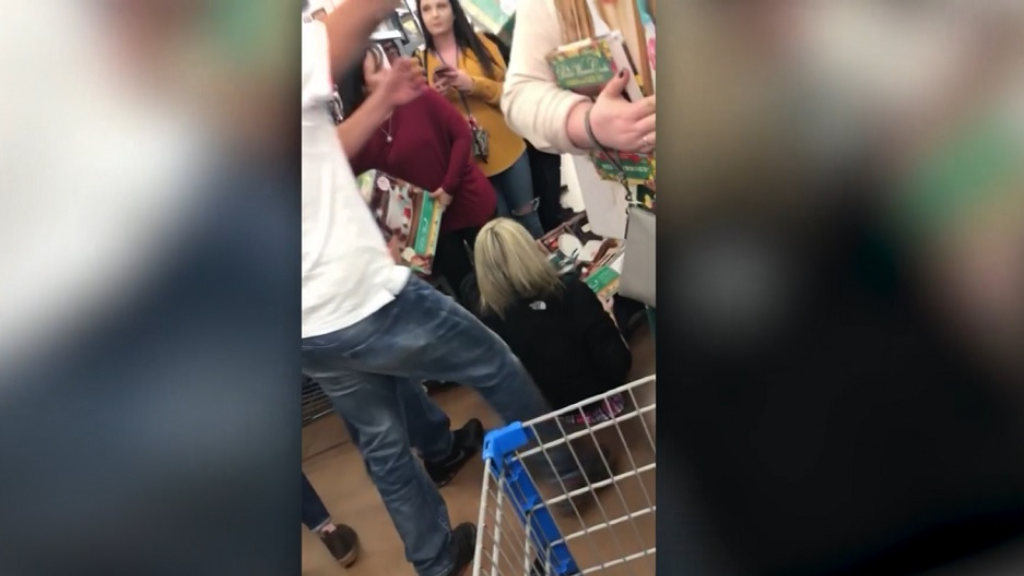 Photo: Two women were seen battling over a box of pots and pans in Walmart, Atlanta for Black Friday sales on November 23, 2018.