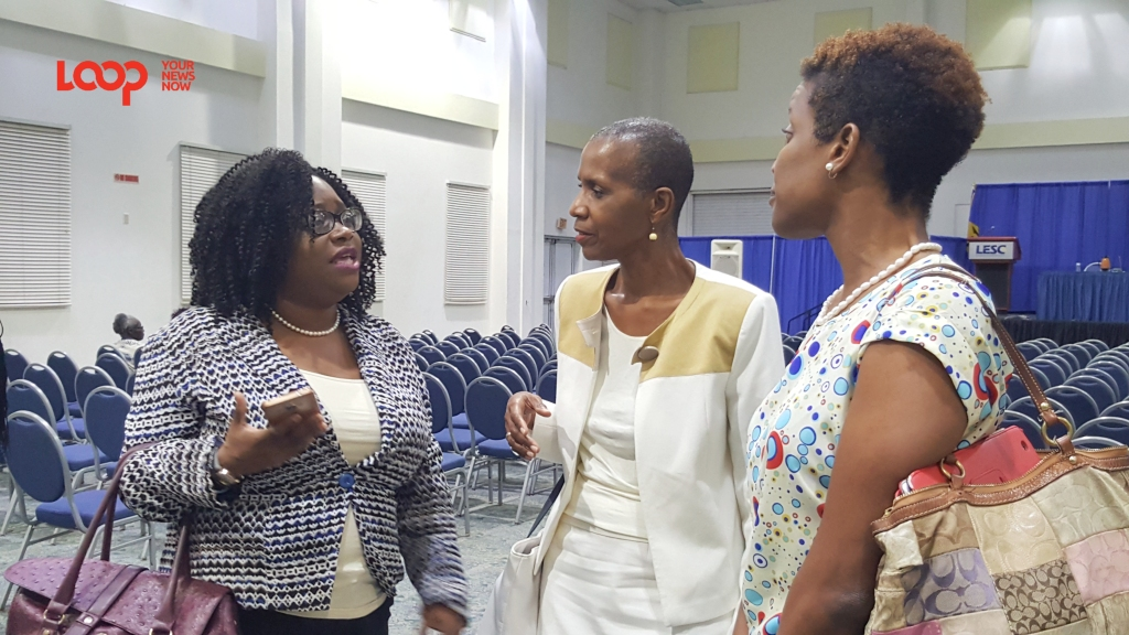 President of Barbados Diabetes Foundation, Trudy Griffith speaking with Senior Health Promotion Officer in the Ministry of Health, Denise Carter-Taylor after the lecture.