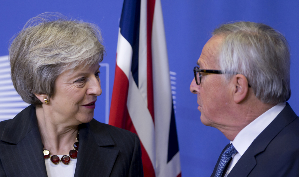 European Commission President Jean-Claude Juncker, right, greets British Prime Minister Theresa May at EU headquarters in Brussels, Wednesday, (AP Photo)