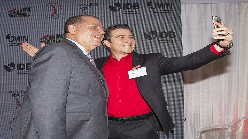 Agriculture Minister Audley Shaw (left) shares a selfie with Red Stripe Managing Director Ricardo Nuncio.