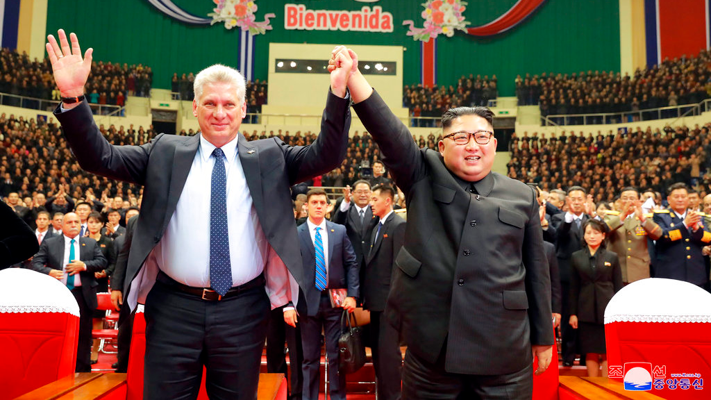 In this Sunday, Nov. 4, 2018 photo released by the North Korean government, Cuban President Miguel Diaz-Canel, left, and North Korean leader Kim Jong Un raised joined hands during a welcome performance in Pyongyang, North Korea. (Korean Central News Agency/Korea News Service via AP)