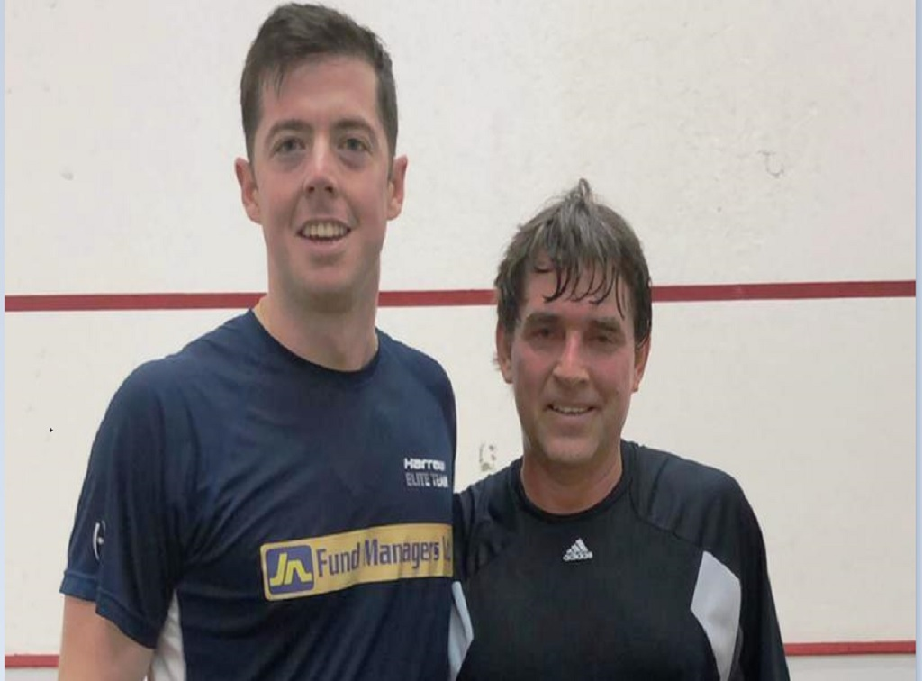 Defending champion, Chris Binnie, (left) and 13-time title winner, Wayne Burrowes pose after their quarter final match in the 2018 BCIC All Jamaica Senior Squash Championships at the Liguanea Club in Kingston on Wednesday, November 21, 2018.