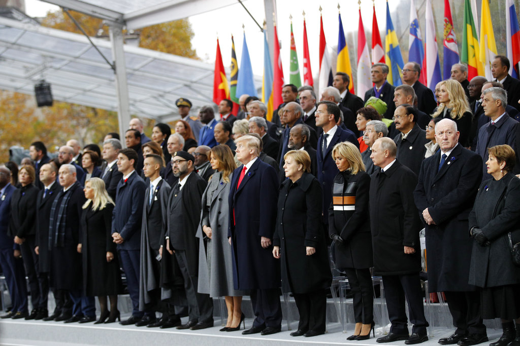 Heads of states and world leaders attend ceremonies at the Arc de Triomphe Sunday, Nov. 11, 2018 in Paris. Over 60 heads of state and government were taking part in a solemn ceremony at the Tomb of the Unknown Soldier, the mute and powerful symbol of sacrifice to the millions who died from 1914-18. (AP Photo/Francois Mori, Pool)