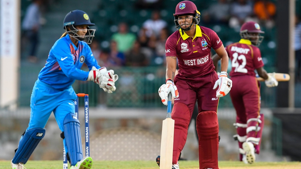 Tanya Bhatia (L) of India stops Chedean Nation (R) of Windies from scoring during a warm-up match at Coolidge Cricket Ground on November 4, 2018 in Coolidge, Antigua