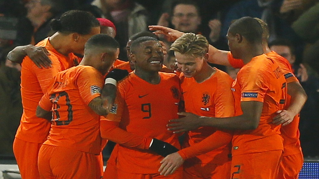 Netherlands players celebrate their Nations League victory over France at the De Kuip stadium in Rotterdam, Netherlands, Friday, Nov. 16, 2018.
