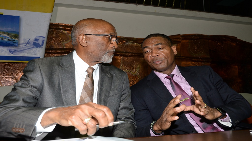 Carlton Earl Samuels (left), Chief Development Financing Officer at the Jamaica National Group, converses with Mark Barnett, President of the National Water Commission, during the Incorporated Masterbuilders Association of Jamaica Conference held at the Jamaica Conference Centre in Kingston on Tuesday,