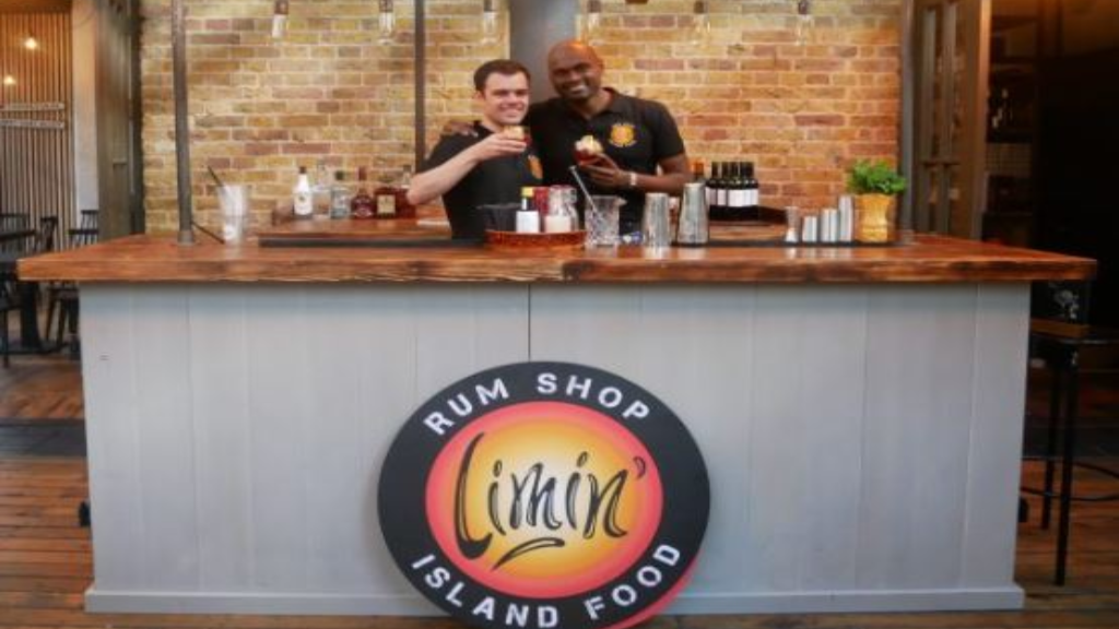 At right, Sham Mahabir, owner of pop-up Trini restaurant, Limin'. Photo via Old Spitalfields Market.
