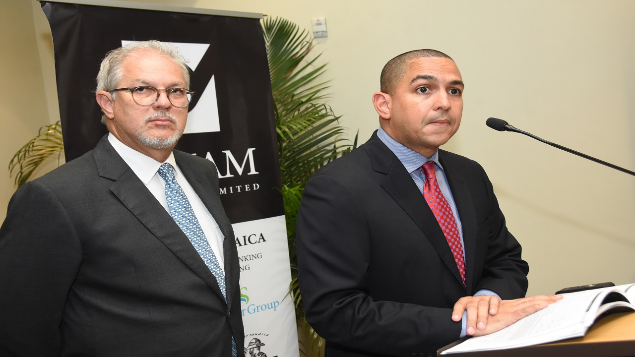 PanJam Investment Chairman and CEO Stephen Facey (left) and Chief Financial Officer Stephen Phillibert at the company's AGM on Thursday. (Photo contributed)