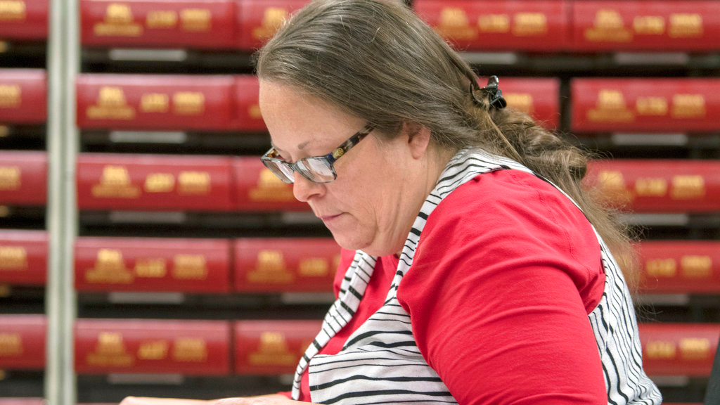 Kim Davis, the county clerk for Rowan County in Kentucky, works with the county election board on Election Day, Tuesday, Nov. 6, 2018, in Morehead, Ky. Davis, who went to jail in 2015 for refusing to issue marriage licenses to same-sex couples, has lost her bid for a second term as county clerk. (AP Photo/John Flavell)