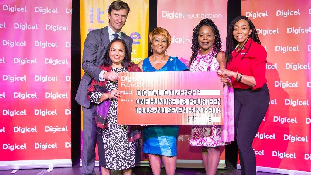 Alex Matuschka, Digicel Group CEO and Penny Gomez, CEO Digicel Trinidad and Tobago Foundation (far right) strike a pose with (from left) the Vice-Principal of Chaguanas North Secondary School, and Principal and Teacher of Barrackpore East Secondary School.