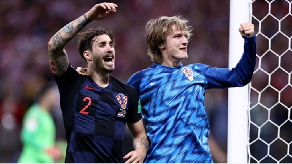Sime Vrsaljko and Tin Jedvaj celebrate for Croatia.