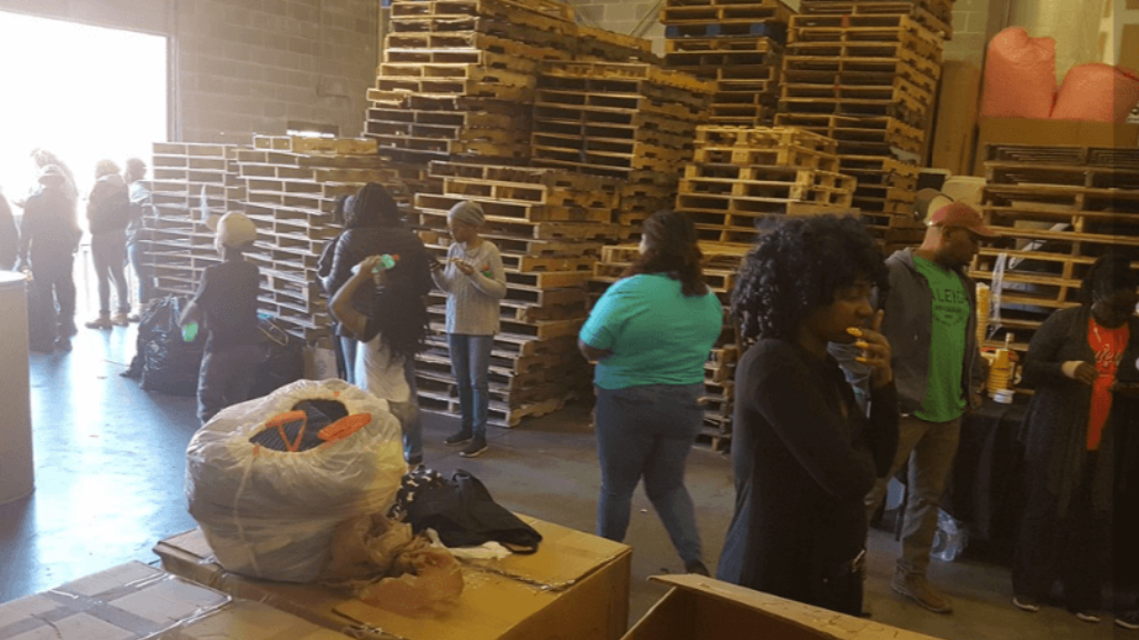 Students and volunteers with the Caribbean Association of Georgia gathered Saturday to send relied items to Trinidad and Tobago at Larparkan Shipping in Decatur. Image via 11alive.com