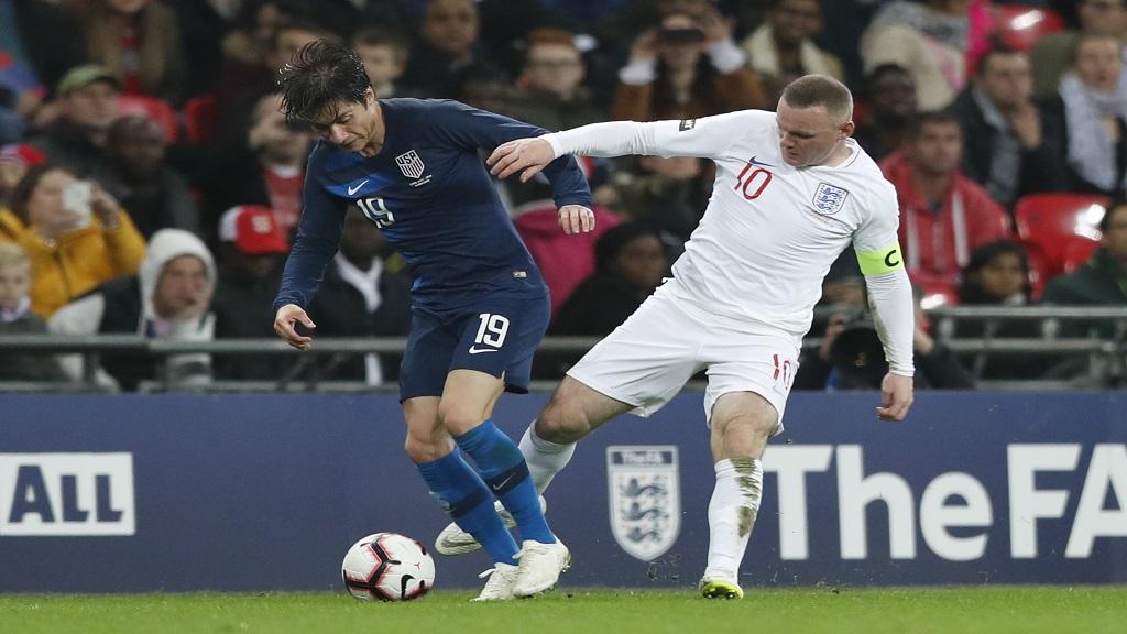 England's Wayne Rooney fouls Unites States Jorge Villafana during the international friendly football match against the United States at Wembley stadium, Thursday, Nov. 15, 2018.