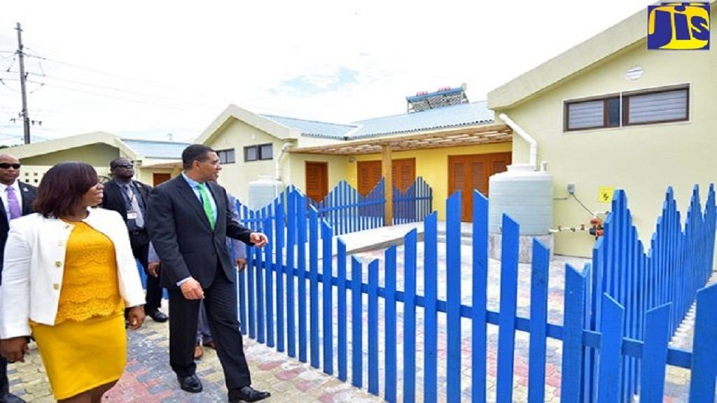Prime Minister Andrew Holness (right) is led on a tour of the Jamaica-China Goodwill Infant School in West Central St Andrew by Principal Suelyn Ward-Brown. The school, one of two built under a co-operation agreement with the Government of China, was officially opened on last Wednesday.