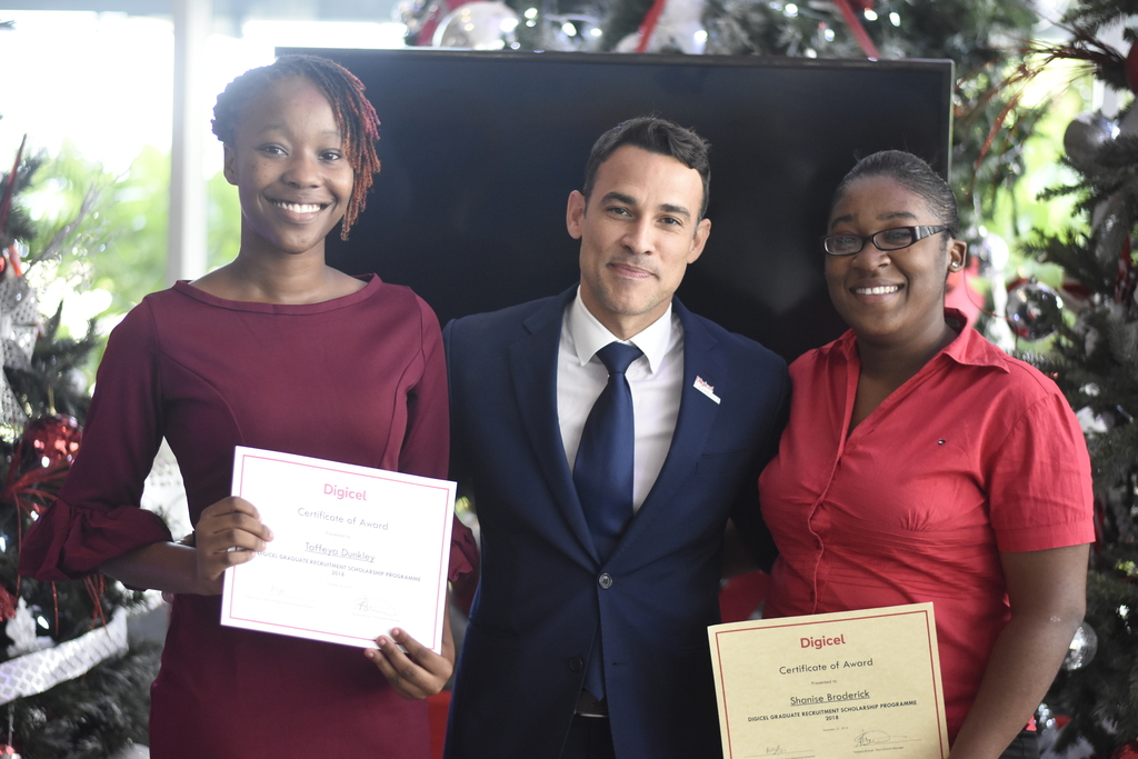 Digicel Jamaica CEO Justin Morin (centre) and two of the company's scholarship recipients were all smiles following the awards ceremony on Tuesday. (Photo: Marlon Reid)