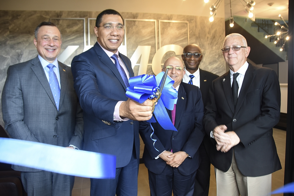 Firm Controller for KPMG LLP, Joseph Arena (left); Prime Minister Andrew Holness; Managing Partner for KPMG in Jamaica, Tarun Handa;  Partner for Outsourcing at KPMG, Donald Barnett and Rev Ronald Thwaites gathers for the ribbon cutting ceremony of KPMG Jamaica Extended Support Services (K-JESS) on Tuesday.