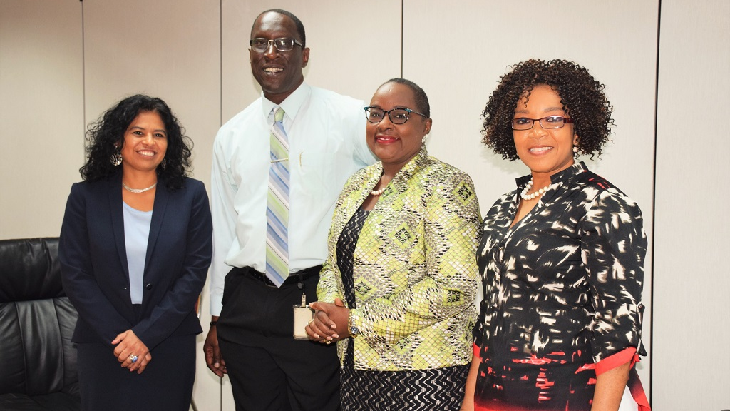From left: Ms. Rocio Medina-Bolivar, IDB's Country Representative;  Captain (Retired) Neville E. Wint, Relief Officer, the Office of Disaster Preparedness and Management (ODPM); Planning and Development Minister, the Honourable Camille Robinson-Regis and Ms. Jill De Bourg, President, Trinidad and Tobago Red Cross after officially signing the IDB emergency grant agreement.