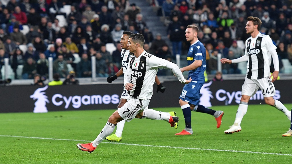 Juventus' Cristiano Ronaldo scores his side's opening goal during a Serie A football match against SPAL, at the Turin Allianz Stadium, Italy, Saturday, Nov. 24, 2018.