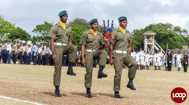 Members of the Barbados Defence Force (BDF) with the monumental trident during the parade to start the 50th celebrations. (FILE)