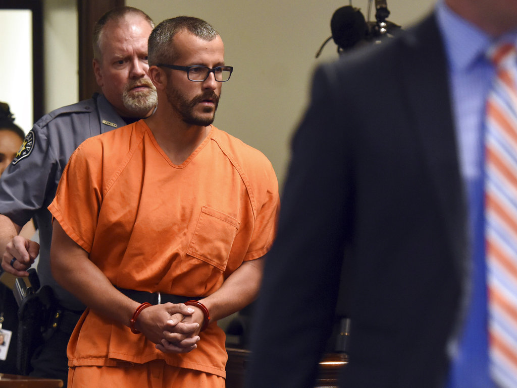 FILE - In this Aug. 16, 2018, file photo, Christopher Watts is escorted into the courtroom before his bond hearing at the Weld County Courthouse in Greeley, Colo. Charges were filed Monday, Aug. 20, 2018, against 33-year-old Watts in the deaths of his pregnant wife and their two young daughters. (Joshua Polson/The Greeley Tribune via AP, Pool, file)