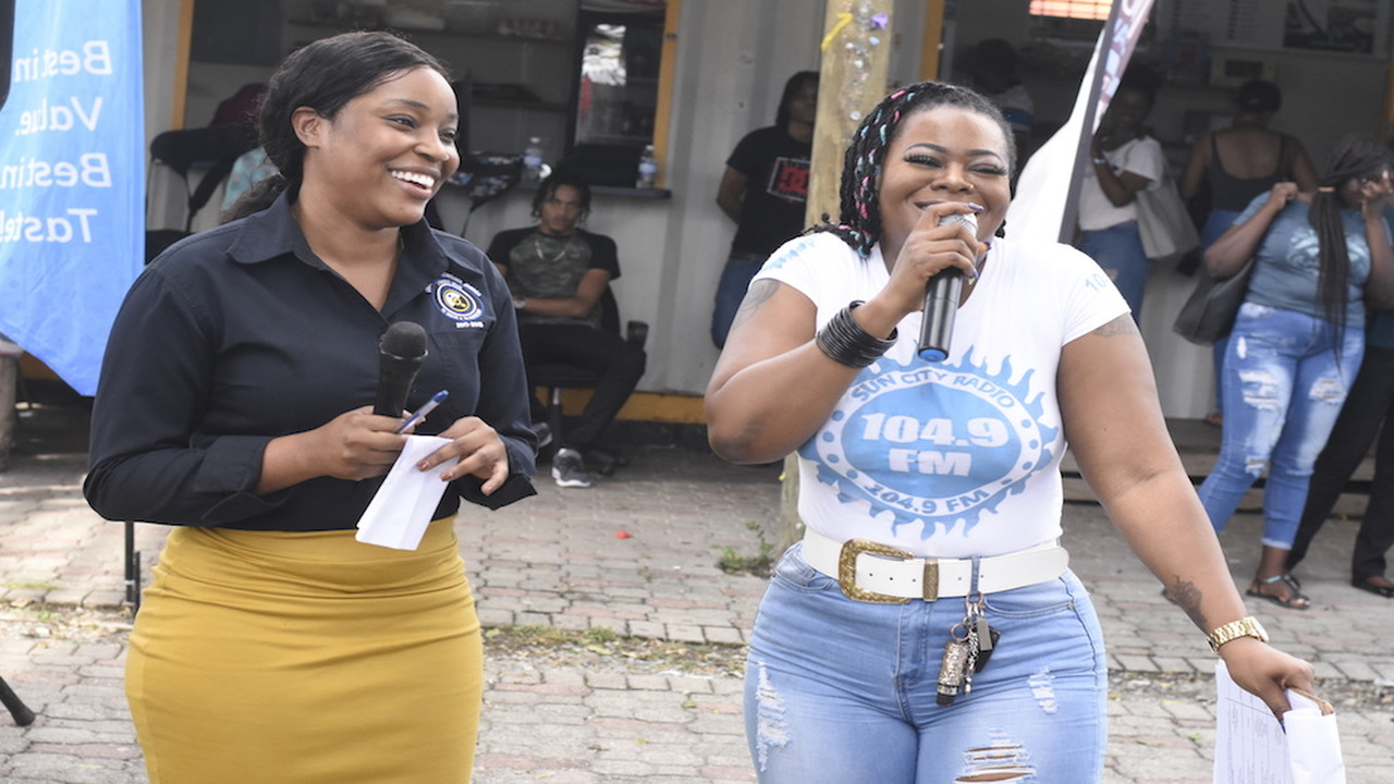 Tia Ferguson, President of the Students Union at the University of Technology Jamaica, with host Stacious at SunCity's Campus Invasion. (PHOTOS: Marlon Reid)